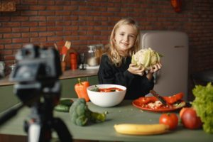 girl-in-the kitchen holding a cabbage